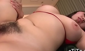 Busty oriental charms two hunks with greedy titty fuck