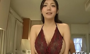 Oriental strokes her own bumpers before giving hot blowjob